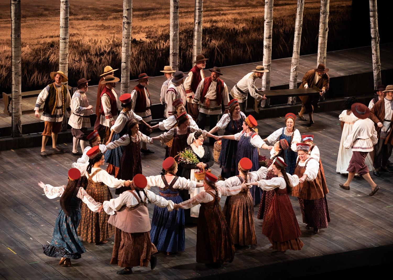 Seattle Opera Chorus and Margaret Gawrysiak (Madame Larina). Philip Newton photo